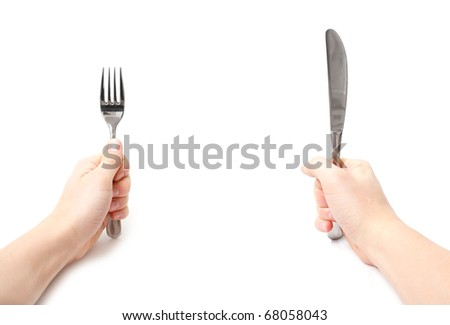 Hands holding knife and fork - stock photo