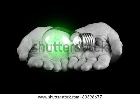 Hands holding light bulb isolated on black - stock photo