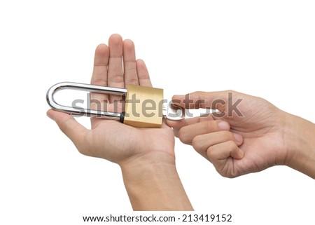 Hands holding, locking and unlocking brass padlock isolated over white background  - stock photo