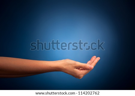 Hands holding on blue background - stock photo