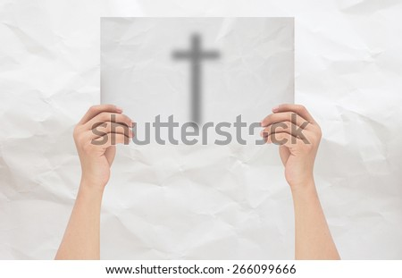 hands holding or showing Cross on white crumpled paper with white crumpled paper background,hands isolated with path / paths - stock photo