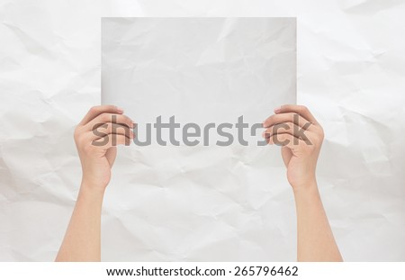 hands holding or showing empty white crumpled paper with white crumpled paper background,hands isolated with path / paths - stock photo