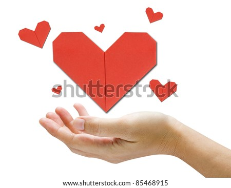 Hands holding origami red heart - stock photo