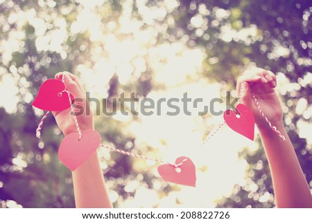 Hands holding paper heart . Instagram effect - stock photo