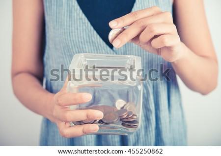 hands holding piggy bank show money dollar bills and coin in piggy bank. business savings finance concept - stock photo