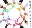 Hands holding puzzle forming circle - stock photo