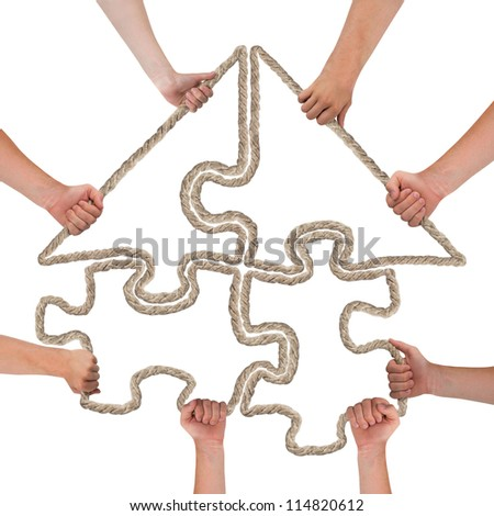 Hands holding puzzle, house concept - stock photo