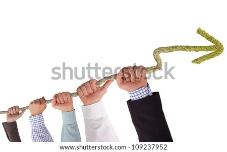 Hands holding rope with yellow arrow, concept of stagnation - stock photo