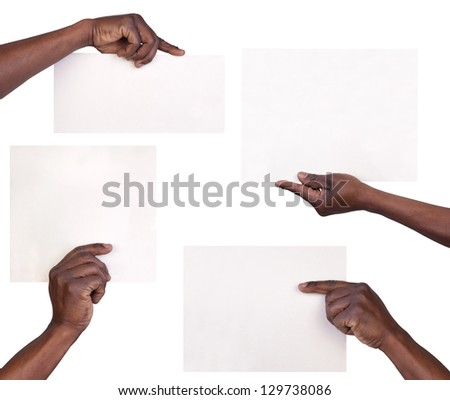 Hands holding sheets of paper isolated on white background - stock photo