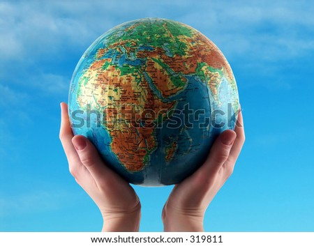 hands holding the, clear sky background - stock photo