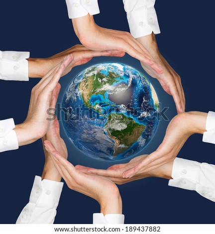 Hands holding the earth. Elements of this image furnished by NASA.