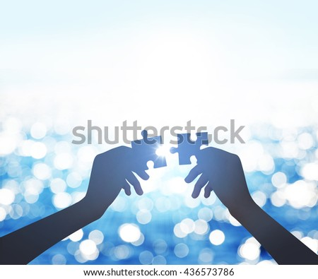 hands holding the missing piece. Teamwork and partnership concept - stock photo