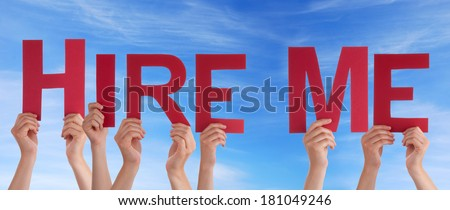 Hands Holding the Words Hire Me in Front of a blue Sky - stock photo