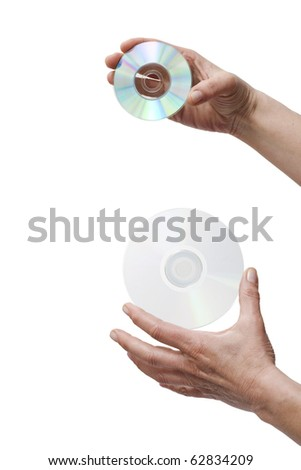 hands holding two dvd - stock photo