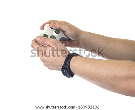 hands holding video game controller - stock photo