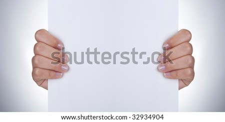 hands holding white empty paper - stock photo