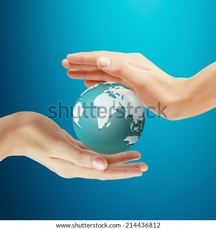 Hands holding world - stock photo