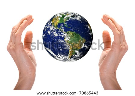 Hands holding world over white background. - stock photo