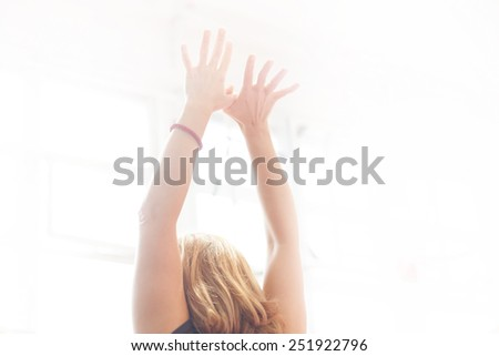 hands in air during yoga exercise - stock photo