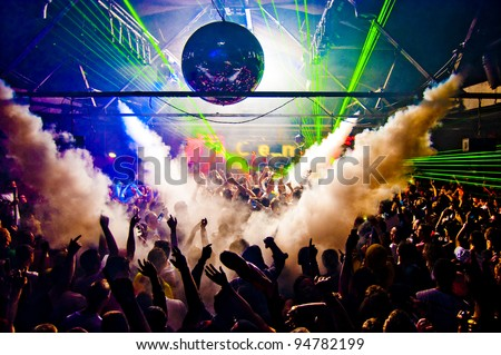 Hands In Air Rave With Smoke Machine and Laser Crowd - Nightclub