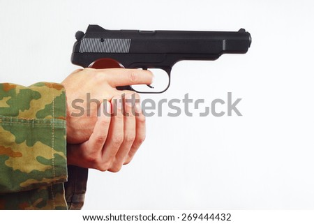 Hands in camouflage uniform with semi-automatic gun on a white background - stock photo