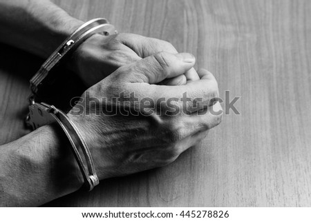 hands in handcuffs - stock photo