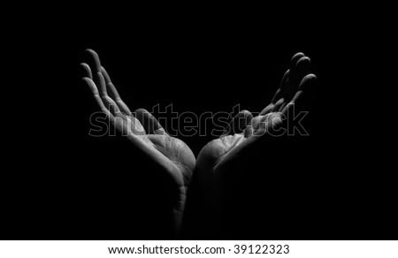 hands in the dark - stock photo