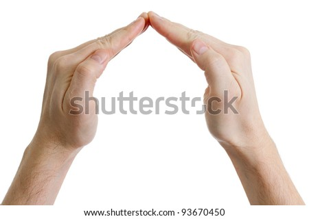 hands in the shape of house on white background - stock photo
