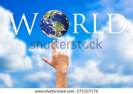 hands indicate on the earth on blurred blue sky backgrounds. Elements of this image furnished by NASA - stock photo