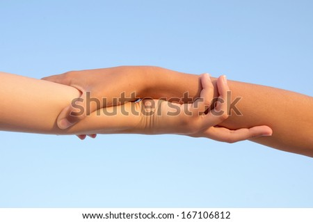 hands isolated in blue sky - stock photo