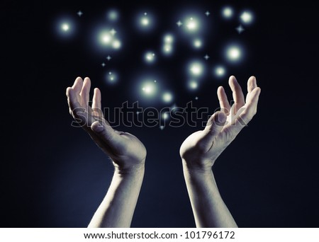 Hands joined together with glow light - stock photo