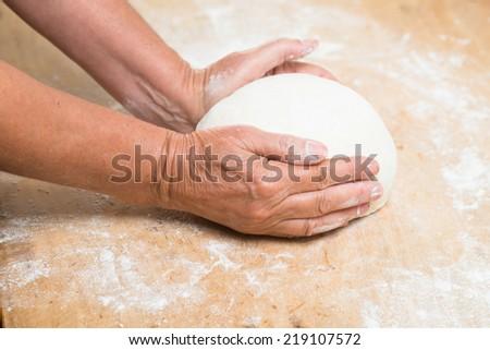 hands knead bread - stock photo