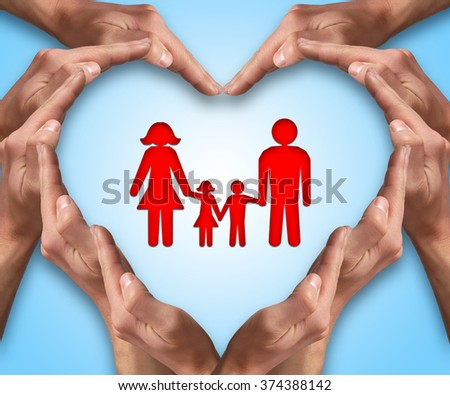 Hands make heart shape with a family in center. Love and protection concept. Family insurance