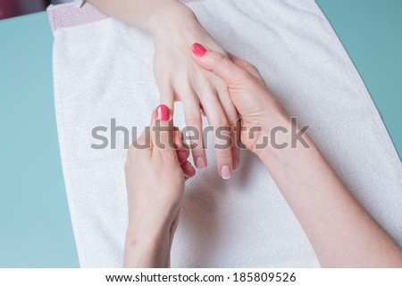 Hands massage in the spa salon in the garden