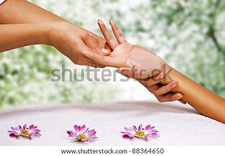 Hands massage in the spa salon in the garden - stock photo