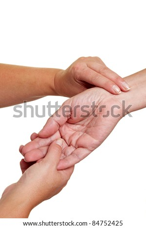 Hands measuring blood preasure with fingers at wrist - stock photo