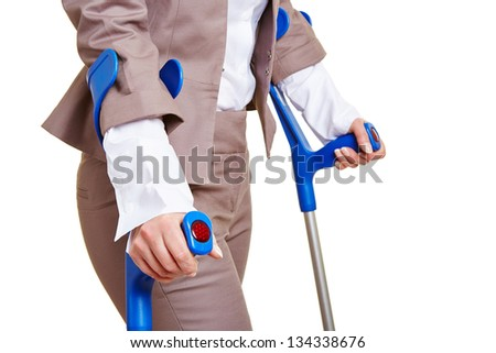 Hands of a business woman walking with two crutches