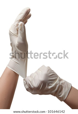 Hands of a doctor in a sterile gloves - stock photo