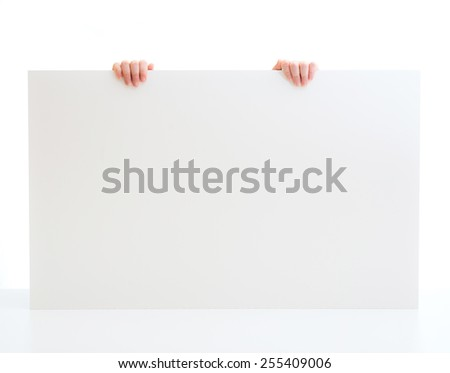 hands of a little girl holding a poster with space for text - stock photo