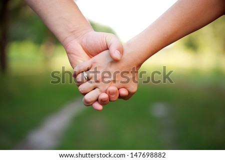 Hands of a loving couple. Concept of friendship and love - stock photo