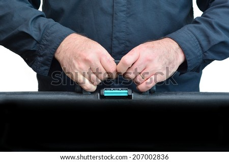 Hands of a man carry travel suitcase against white background with copy space. Concept photo of travel, vacation, holiday, destination, tourism, traveler, tourist. - stock photo