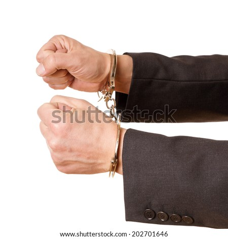 hands of a man with handcuffs on a white background - stock photo