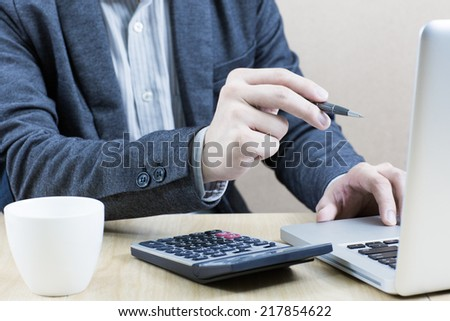 Hands of a man working with laptop
