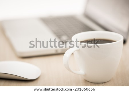 Hands of a man working with laptop and cup of coffee - stock photo