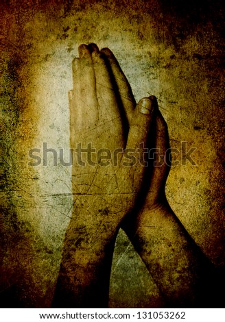 Hands of a person raised together in prayer sepia toned - stock photo