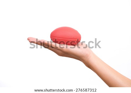 Hands of a woman holding a stress ball on white background - stock photo