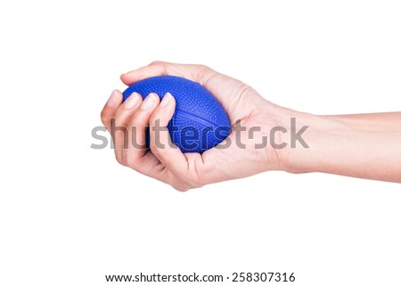 Hands of a woman squeezing a stress balls - stock photo