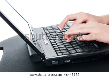 hands of a young girl working on laptop