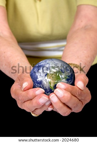 hands of an eldery woman holding an earth globe - globe is from http://www.nasa.gov