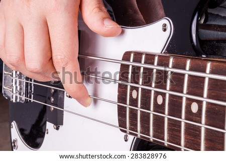 Hands of an female teenager plays guitar, Isolated on white - stock photo